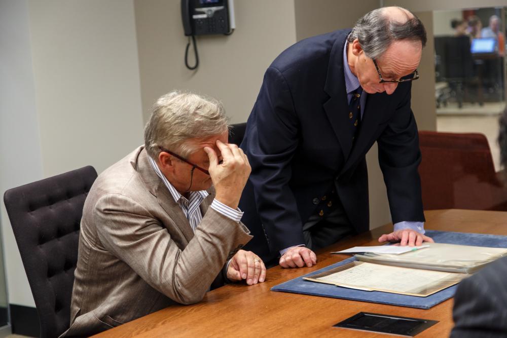 John Grisham viewing Fitzgerald Manuscripts. (photograph by Shelley M. Szwast)